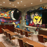 Jungle and space themed graffiti art takes meetings to a new level